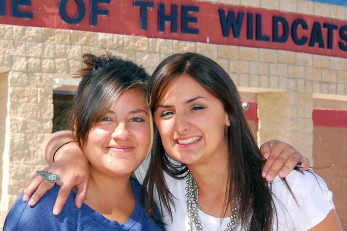 Vicky Garza, left, and Montiqua Speir pose for a photograph on April 5, 2012 in Deming, N.M.  Speir, 18 and   Garza, 18, both seniors, were selected by Santa Fe-based production company Littleglobe and the GEAR UP New Mexico program to be featured in the