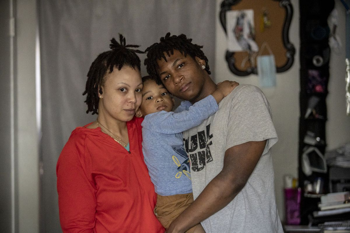 MEMPHIS, TN - March 16, 2021: Jalan Clemmons, a freshman at Hamilton High School, stands for a portrait with mother, Anna Nuby, his 2-year-old brother Kobi.
