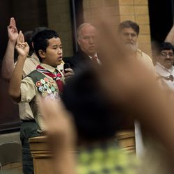 Scouts recite the Scout Oath during a Court of Honor ceremony at the Camp Tracy Lodge in Salt Lake City on Wednesday, Sept. 28, 2016.