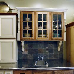 These kitchen cupboards are above the stainless counter at the home of Eddy Rall and Patty Momenee.