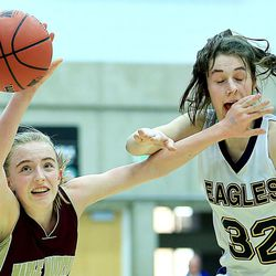 Maple Mountain's Liz Eaton and Skyline's Laurel Tomlinson battle for the ball during play Friday, Feb. 20, 2015, in 4A semifinal action at Salt Lake Community College in Taylorsville.