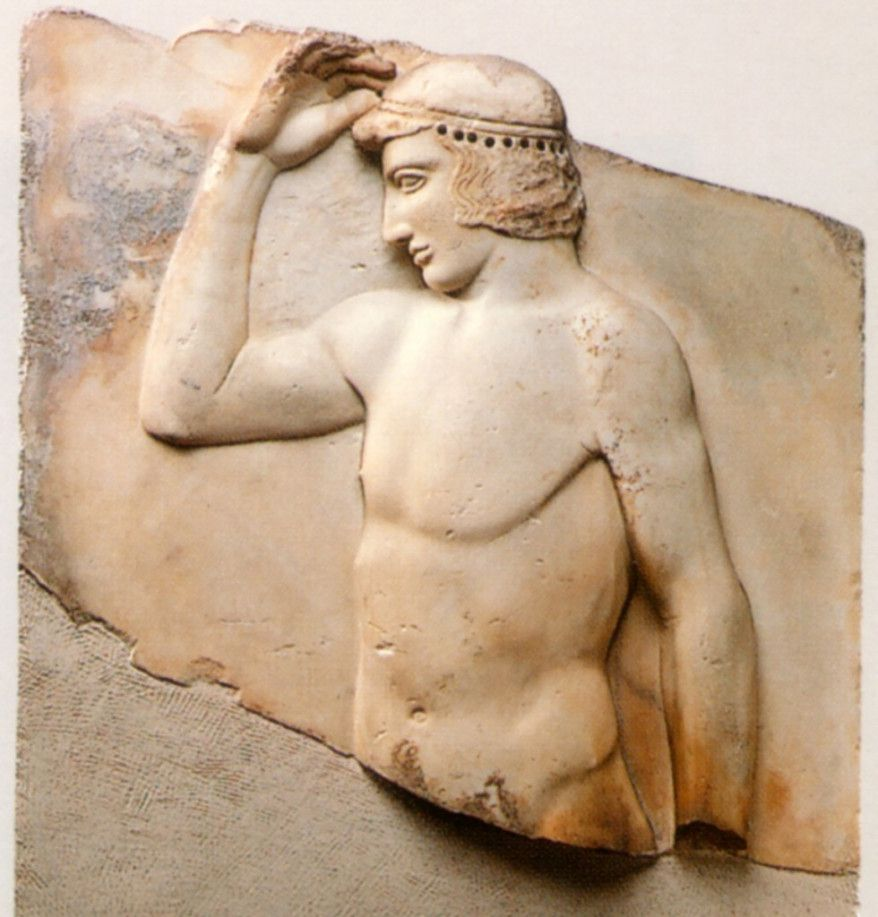 """Relief of a Youth Crowning Himself, part of """"The Greeks: Agamemnon to Alexander the Great"""" at the Field Museum. 