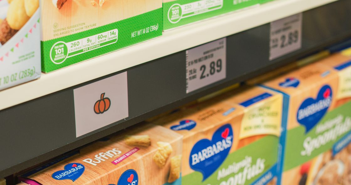 Shelves are equipped with digital signs that direct customers to their desired product.