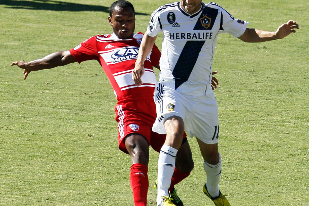 CARSON, CA - AUGUST 26: Julian de Guzman #12 of FC Dallas and Mike Magee #18 of Los Angeles Galaxy battle for the ball during the MLS match at The Home Depot Center on August 26, 2012 in Carson, California. (Photo by Ric Tapia/Getty Images)