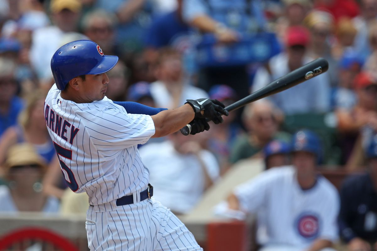 CHICAGO, IL - JULY 15: Darwin Barney #15 of the Chicago Cubs hits a two-run home run in the 2nd inning against the Arizona Diamondbacks at Wrigley Field on July 15, 2012 in Chicago, Illinois. (Photo by Jonathan Daniel/Getty Images)