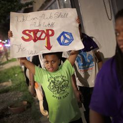 Signs promoted peace. | Scott Olson/Getty Images