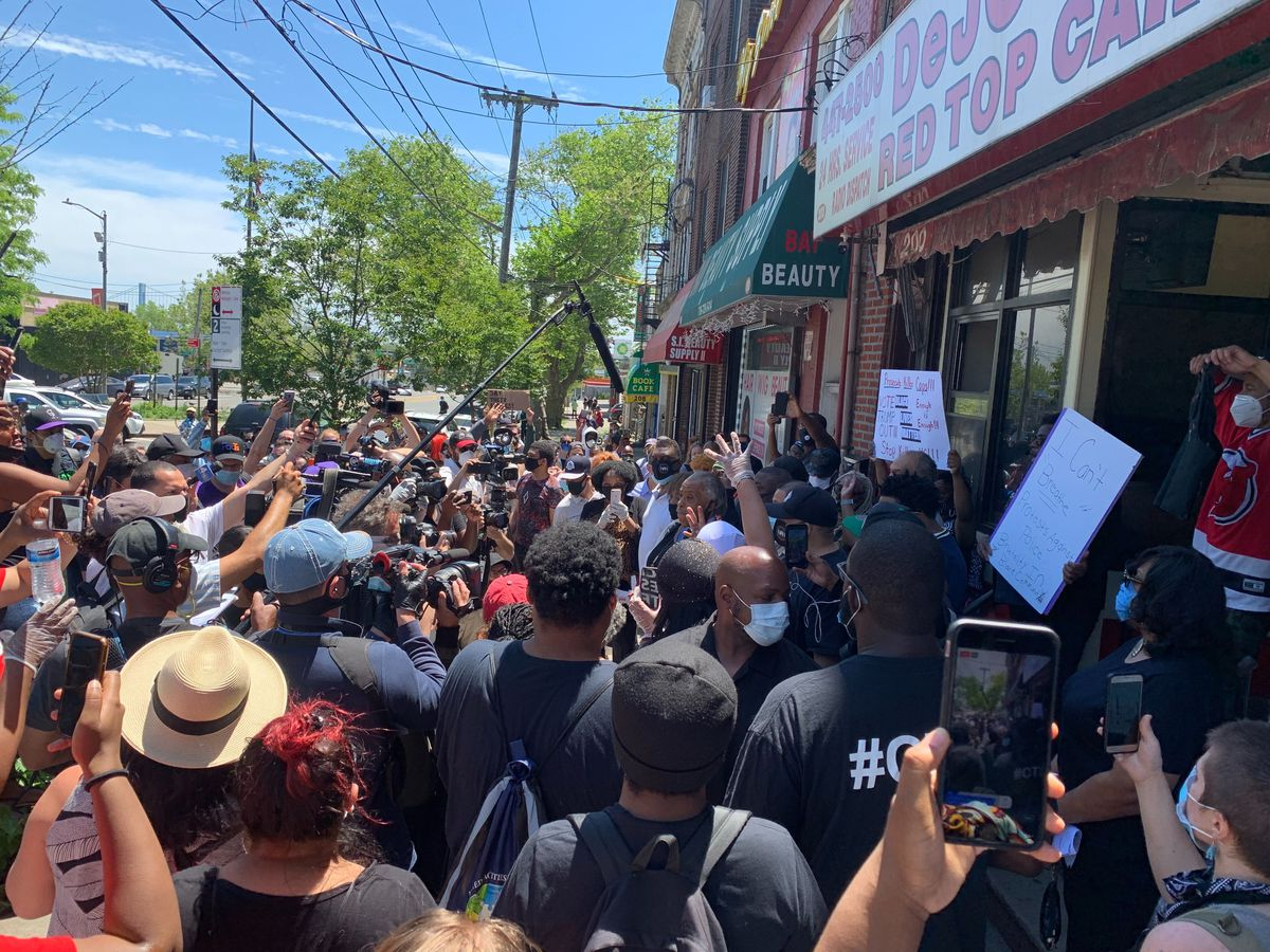 The Rev. Al Sharpton is all but obscured by the crowd during a visit to the Staten Island street where Eric Garner died at the hands of police in 2014.