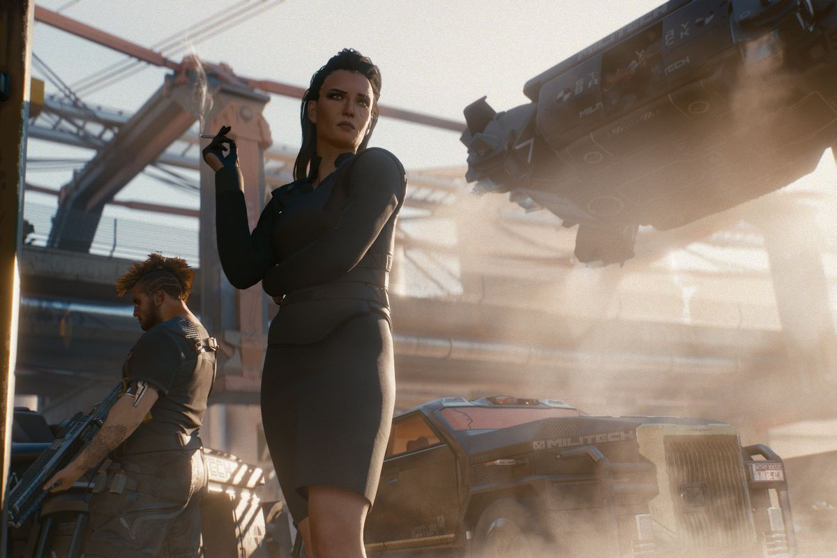 """Cyberpunk 2077, E3 2018 - A sharply-dressed woman in a bulletproof vest and a short black skirt. She's smoking a cigarette next to an armed male guard. The SUV behind them reads """"Militech"""" on the fender."""