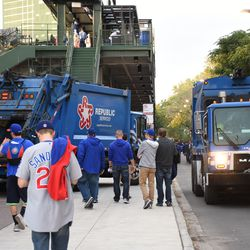 5:14 p.m. Garbage truck outside of Gate R, on Sheffield, being relieved by another truck -