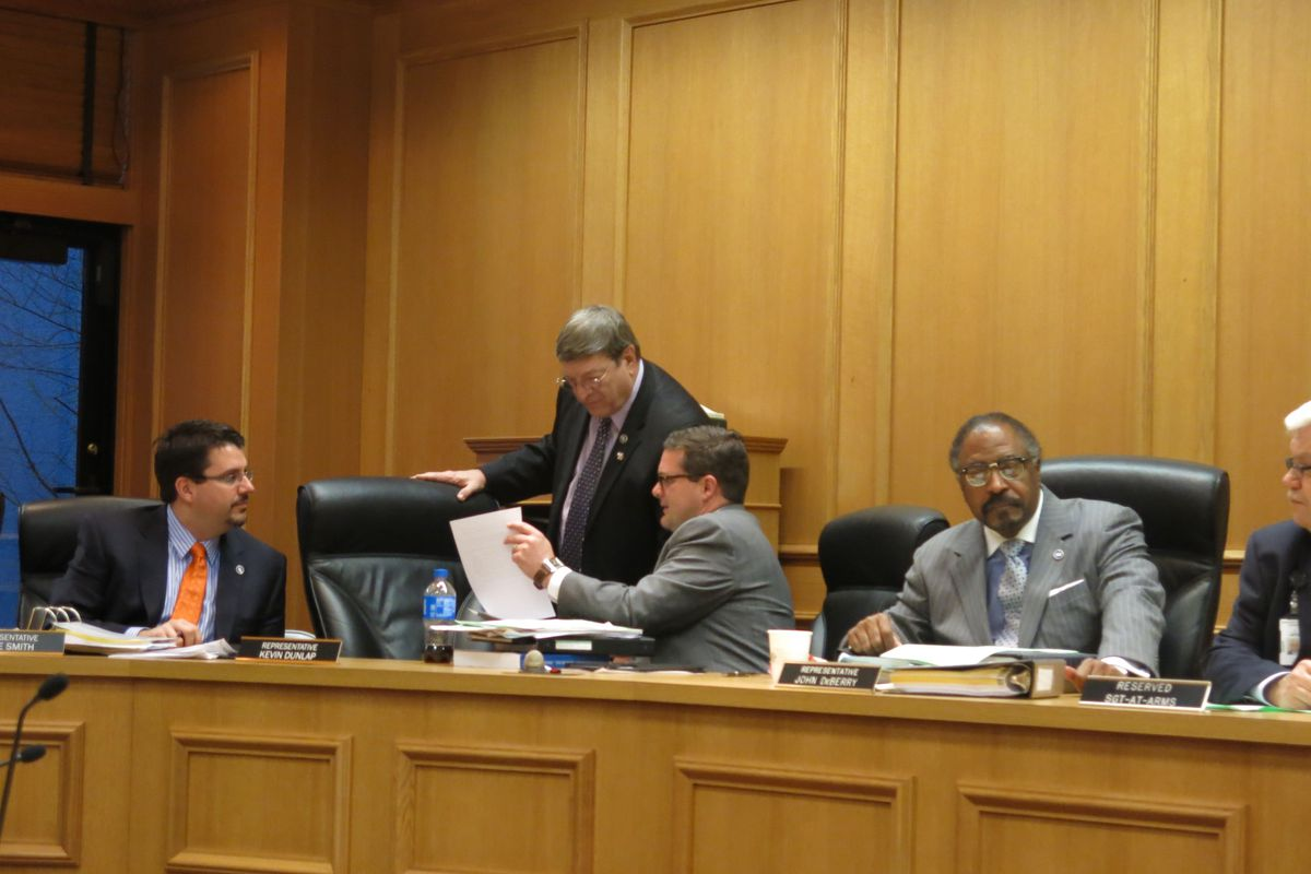 Rep. Harry Brooks (R-Knoxville) and Rep. Kevin Dunlap (D-Rock Island) discuss legislation prior to a House education panel on Tuesday. Lawmakers are discussing numerous bills related to Tennessee's Common Core State Standards.