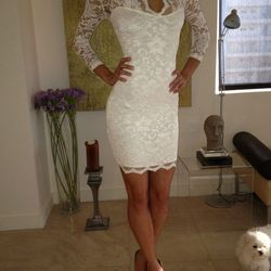 "ASOS lace cream dress, <a href=""http://www.ebay.com/itm/Lilly-Ghalichi-All-Lace-Cream-Dress-/181055648622?pt=US_CSA_WC_Dresses&hash=item2a27c1f36e"">$228.50</a>."