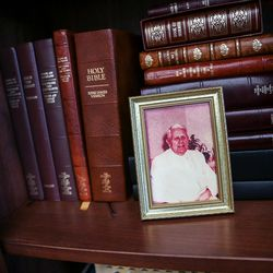 A framed photo of Selvoy J. Boyer, mission president for Elder M. Russell Ballard when he served in England, is displayed in Ballard's office at the Church Administration Building in Salt Lake City on Friday, June 30, 2017.