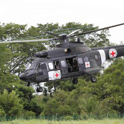 A Brazilian air force helicopter emblazoned with the Red Cross logo takes off from an airfield to pick up members of the last group of soldiers and police held by Colombia's main rebel group, in Villavicencio, Colombia, Monday April 2, 2012. The leftist Revolutionary Armed Forces of Colombia, known as the FARC, has promised to free the 10 captives, likely in several stages. All have been held for at least 12 years.