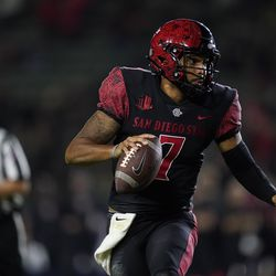 San Diego State quarterback Lucas Johnson (7) runs the ball during overtime of an NCAA college football game against Utah Saturday, Sept. 18, 2021, in Carson, Calif.