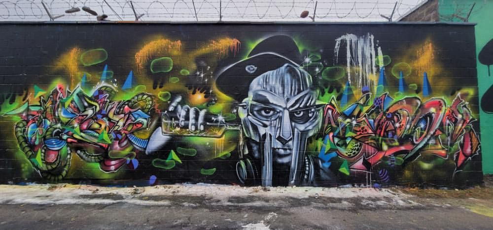 """Uptown-raised artist James Spurgeon incorporated graffiti """"wildstyle,"""" cubism and abstract influences in his mural of the late rapper and hip-hop artist MF DOOM."""
