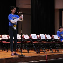 Maya Joshi from the Young Magnet High School adjusts microphone during one of the final rounds of the annual Citywide Spelling Bee Championship at the Lindblom Math and Science Academy on March 14, 2019. The winner will earn the opportunity to represent Chicago Public Schools at the Scripps National Spelling Bee in Washington, D.C., where they will compete against the best spellers from across the nation for the title of 2019 national Spelling Bee Champion and an opportunity to win a $40,000 prize. | Victor Hilitski/For the Sun-Times