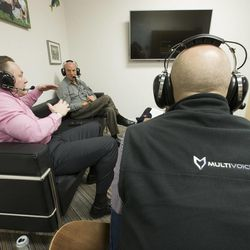 David Politis, right, Todd Rapier, left, and Ron Fraser of Multi-Voice in Provo talk Tuesday, Jan. 13, 2015, about a new technology that allows multiple users to communicate via walkie-talkie.