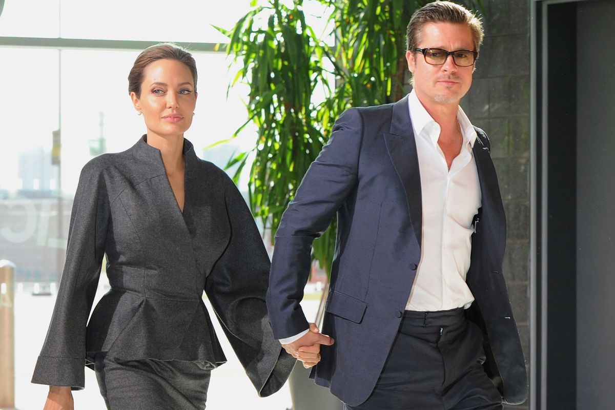 UN Special Envoy and actress Angelina Jolie and Actor Brad Pitt attend the Global Summit to End Sexual Violence in Conflict at ExCel on June 13, 2014 in London, England.