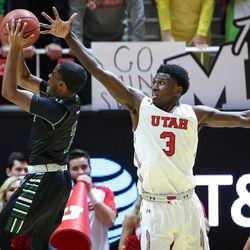 Utah Utes guard Justin Bibbins (1) and forward Donnie Tillman (3) defend Hawaii Warriors guard Brocke Stepteau's shot as Utah hosts Hawaii at the Huntsman Center in Salt Lake on Saturday, Dec. 2, 2017.