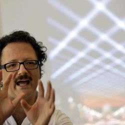 """In this Aug. 23, 2012 photo, artist Rafael Lozano-Hemmer discusses his new project titled """"Open Air,"""" commissioned by the Association for Public Art, in Philadelphia. The interactive light installation using 24 robotic searchlights plans to illuminate the night sky over the Benjamin Franklin Parkway from the scheduled dates of Sept. 20 to Oct 14."""