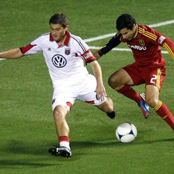 Tony Beltran (right) of Real Salt Lake fights to control the ball against Chris Korb of DC United during their MLS matchup at Rio Tinto Stadium in Sandy Saturday, September 1, 2012