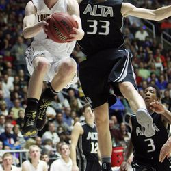 Lone Peak's T.J. Haws drives on Alta's Landon Albrecht during the 5A State Championship game in Ogden Saturday, March 2, 2013.