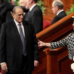 Sister Harriet Uchtdorf reaches out to President Thomas S. Monson as he leaves the afternoon session of the 183rd Annual General Conference of The Church of Jesus Christ of Latter-day Saints in the Conference Center in Salt Lake City on Sunday, April 7, 2013.