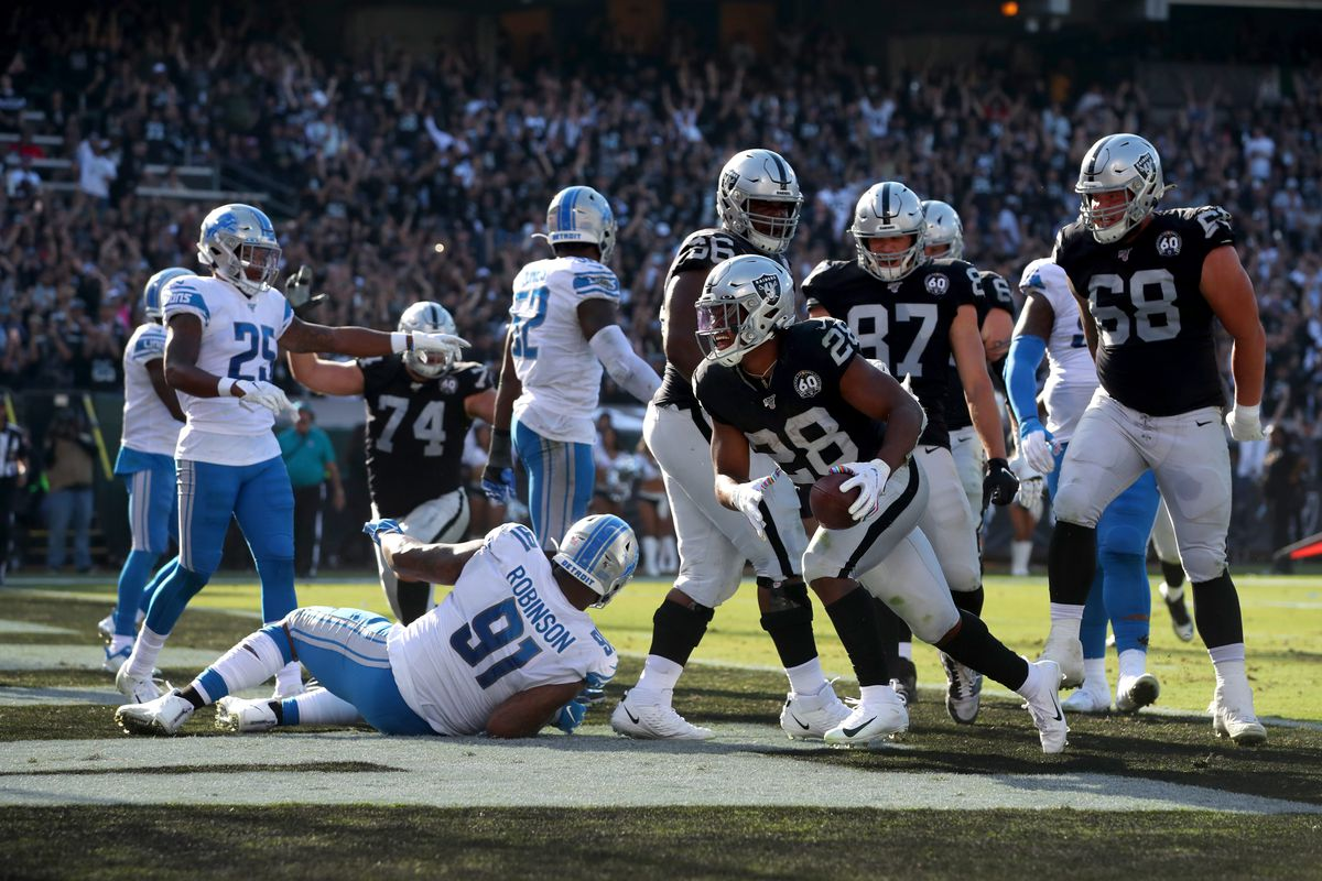 Oakland Raiders running back Josh Jacobs reacts after scoring a touchdown against the Detroit Lions in the second quarter at Oakland Coliseum.