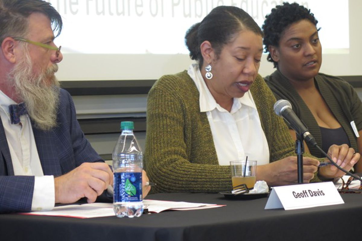 Teacher Geoff Davis (left) and Parent Power co-founder Delana Stardust Ivey (right) listen to Robin Hughes, executive associate dean of the Indiana University School of Education in Indianapolis.