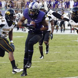TCU wide receiver Brandon Carter (3) pulls in a touchdown pass against Grambling State linebacker Jacarde Carter (54) and defensive back Naquan Smith (26) during the first half of an NCAA college football game in Fort Worth, Texas, Saturday, Sept. 8, 2012.