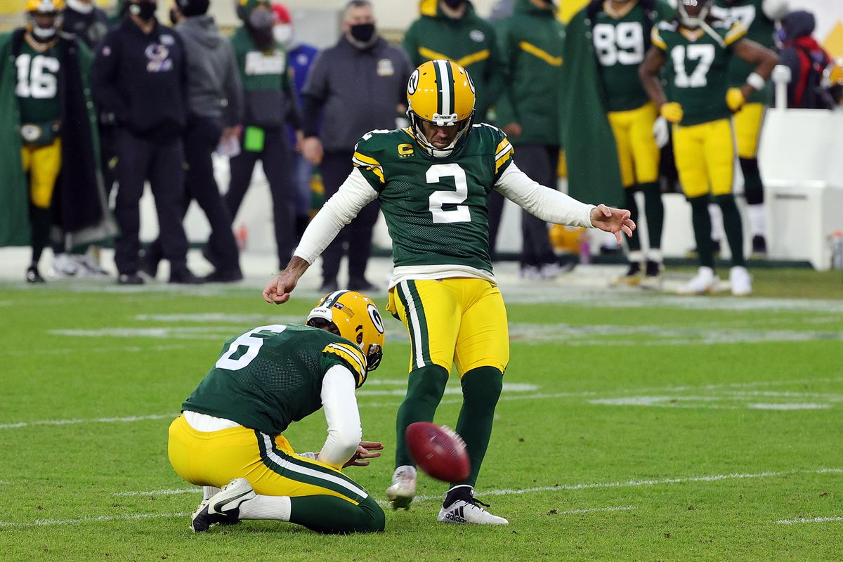 Mason Crosby #2 of the Green Bay Packers kicks a field goal in the first quarter against the Los Angeles Rams during the NFC Divisional Playoff game at Lambeau Field on January 16, 2021 in Green Bay, Wisconsin.