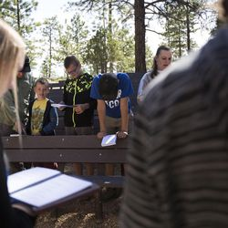 The congregation sings worship songs during the 9:30 a.m. nondenominational Christian church service in Bryce Canyon National Park, Sunday, June 18, 2017.