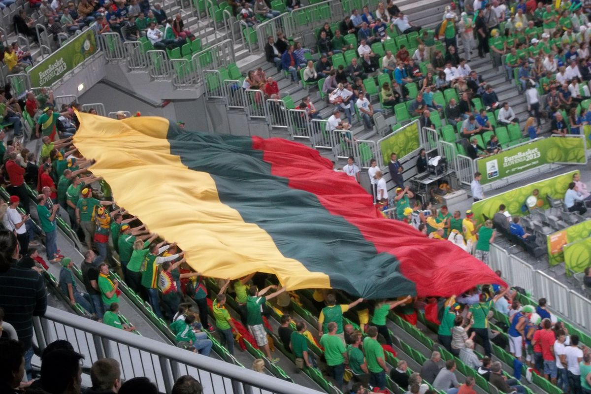 Lithuanians wave their flag proudly as their team reaches the finals for the first time since 2003.