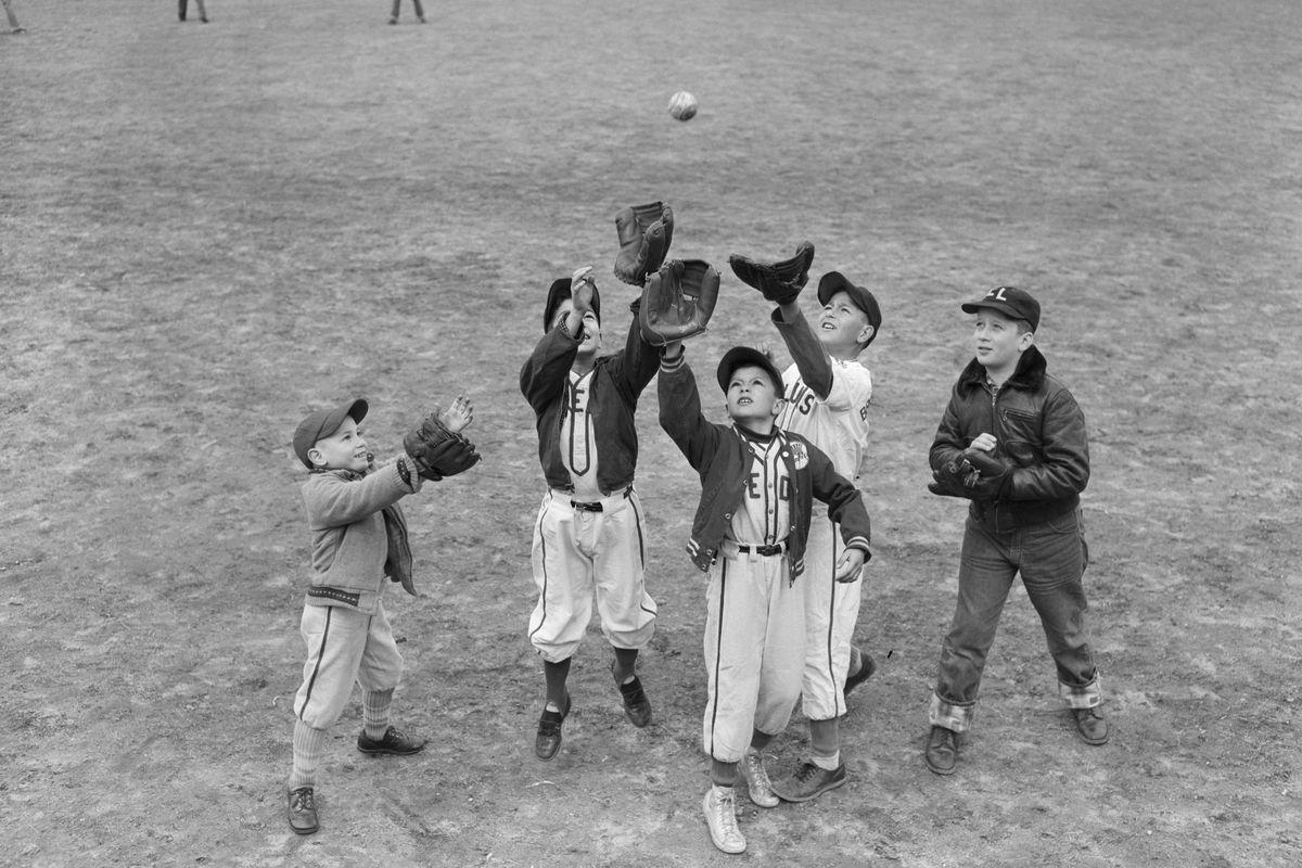 Boys Trying to Catch Softball
