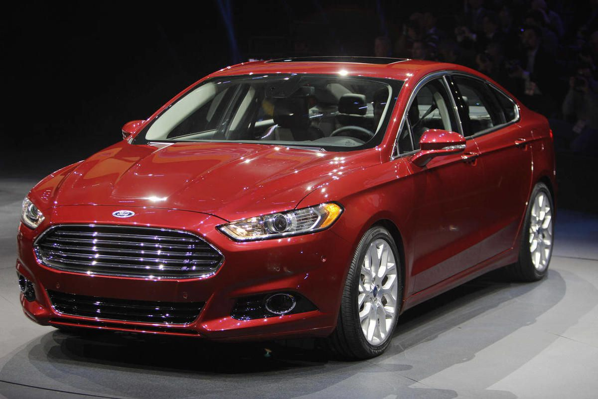 FILE - In this Jan. 9, 2012 file photo, the 2013 Ford Fusion is introduced during the North American International Auto Show in Detroit. Ford hopes the redesigned 2013 Fusion will finally be its Camry killer. The Fusion has become Ford's best-selling car