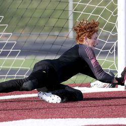 Stansbury goalkeeper Devun Collins blocks a shot during a shoot-out in the 4A boys soccer semifinals against Sky View at Jordan High School in Sandy on Monday, May 17, 2021. Stansbury won in the shoot-out after double overtime.
