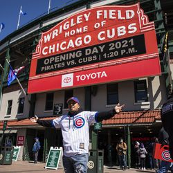 Ivan Aroyo, 25, of Cicero, poses for a photo outside Wrigley Field before the Chicago Cubs Opening Day game against the Pittsburgh Pirates.