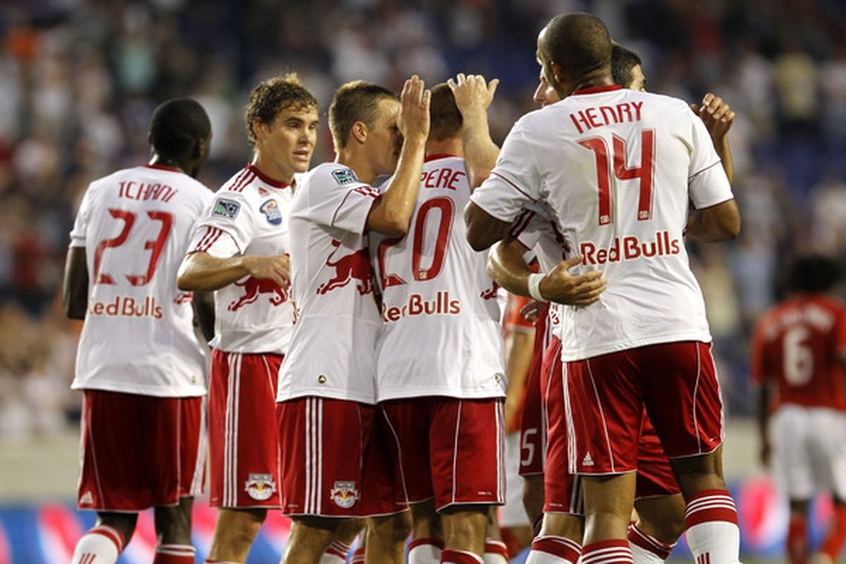 HARRISON NJ - AUGUST 11: Joel Lindpere of the New York Red Bulls is congratulated by his teammates on his goal against the Toronto FC at Red Bull Arena on August 11 2010 in Harrison New Jersey.  (Photo by Chris Trotman/Getty Images)