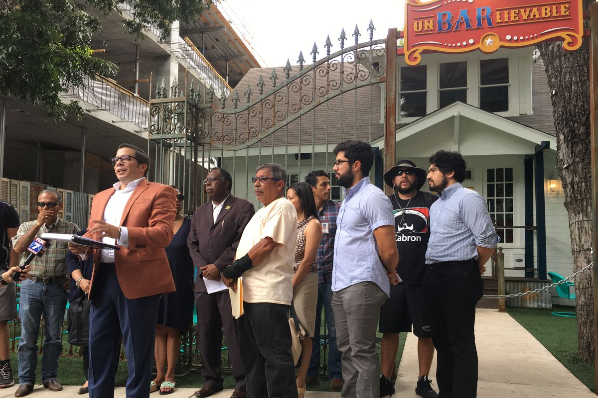 Community activist Marcos Mancillas speaking in front of Unbarlievable
