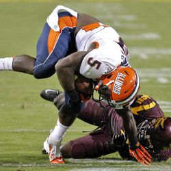 Illinois running back Donovonn Young (5) is tackled by Arizona State safety Alden Darby during the second half of an NCAA college football game, Saturday, Sept. 8, 2012,in Tempe, Ariz.