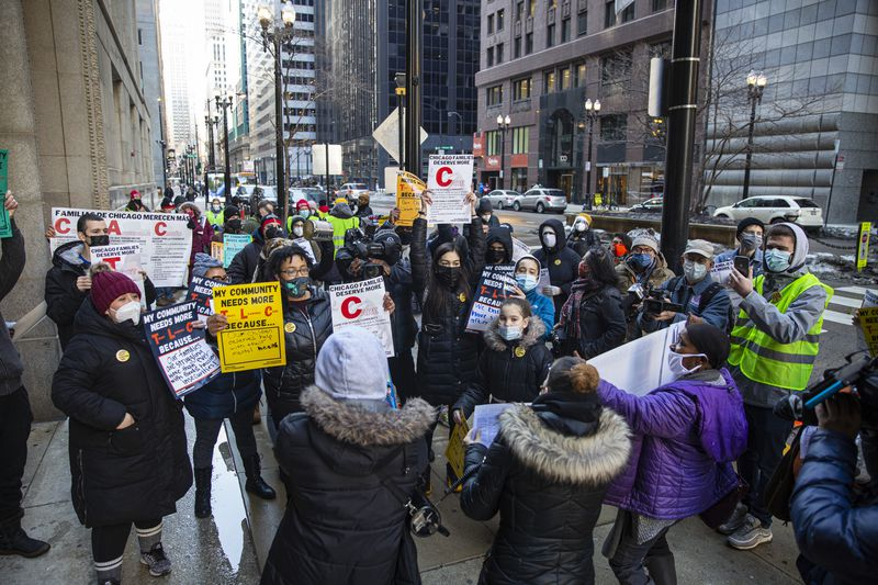 Protestors gather to ask Mayor Lori Lightfoot and deliver a letter to her office to consider and improve policies for Chicago Public Schools during a press conference by CPS parents and Raise for Hand for Illinois Public Education outside of City Hall at 101 N La Salle St in the Loop, Wednesday, Feb. 24, 2021. | Anthony Vazquez/Sun-Times