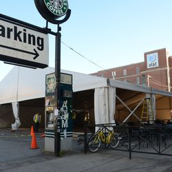 Sun 3:41 p.m. The tent now filling up the entire parking lot, between the 7-Eleven and Starbucks on Addison -