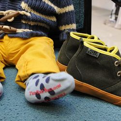 Neon Eaters desert boot in charcoal/lime, $40 at Psychobaby; The Red Balloon Co. polka dot socks in blue, $9 for a pack of two