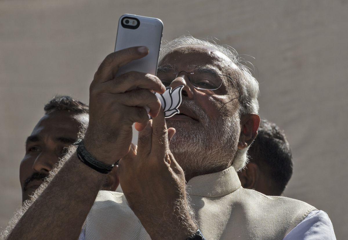 Indian Prime Minister Narendra Modi and his smartphone