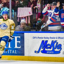 Syracuse Crunch Alex Barré-Boulet (12) and fans celebrate his goal in the Third Period against the Belleville Senators to tie the game in American Hockey League (AHL) action at the War Memorial Arena in Syracuse, New York on Friday, November 8, 2019. Syracuse won 4-3 in OT.