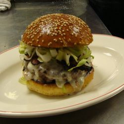 Maialino Burger: A 7 oz beef burger heavy on the brisket served with house-cured bacon, escarole, griddled onions, and gorgonzola cheese. Comes with a side of suckling pig skin puffs (aka house-made pork rinds). $17, served at lunch.