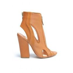 """<a href=""""http://www.kirnazabete.com/sale/cut-out-bootie"""">Isa Tapia Cut-Out Bootie</a> $346.50, was $495"""