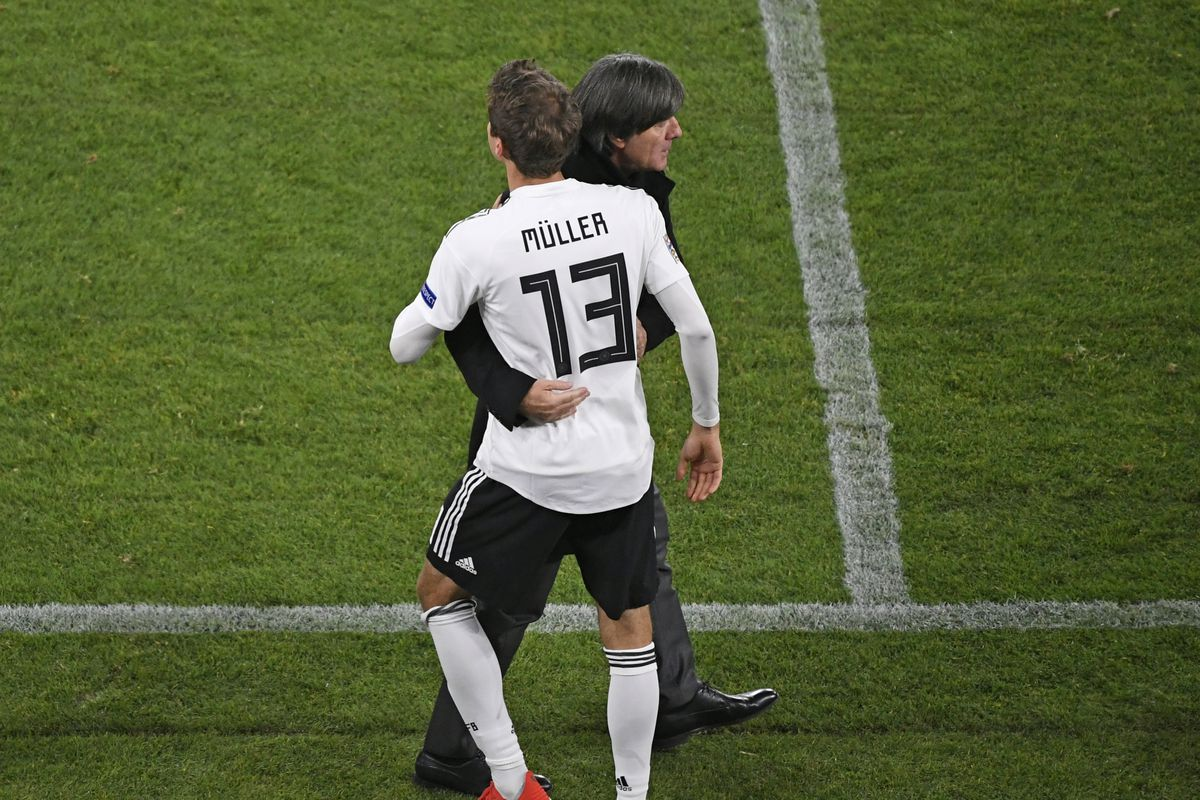 19 November 2018, North Rhine-Westphalia, Gelsenkirchen: Soccer: Nations League A, Germany - Netherlands, Group stage, Group 1, 6th matchday. Thomas Müller from Germany embraces national coach Joachim Löw before his substitution. Photo by Ina Fassbender/picture alliance via Getty Images