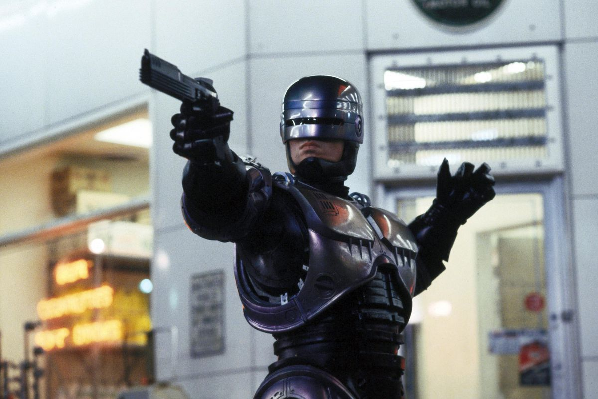 Robocop points a gun