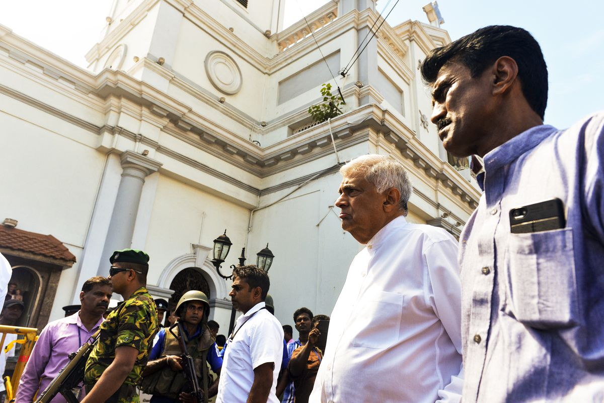 """Sri Lankan Prime Minister Ranil Wickremasinghe (second from right) arrives to visit the site of a bomb attack at St. Anthony's Shrine.  Wickremasinghereleased a statement on Sunday condemning the """"cowardly attacks on our people"""" and asked """"all Sri L"""